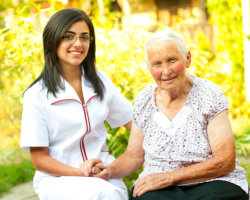 caregiver holding the hand of the patient