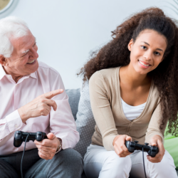 caregiver and patient playing video games