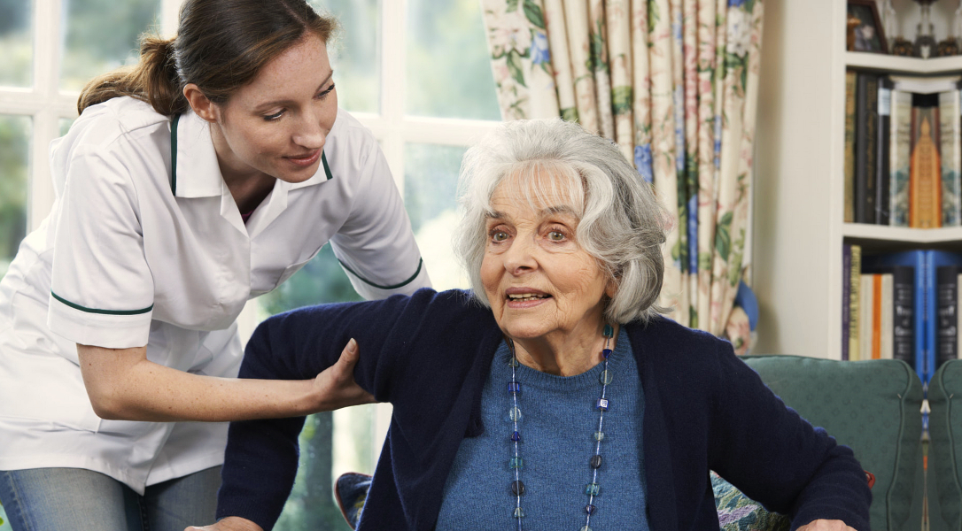 caregiver assisting a senior